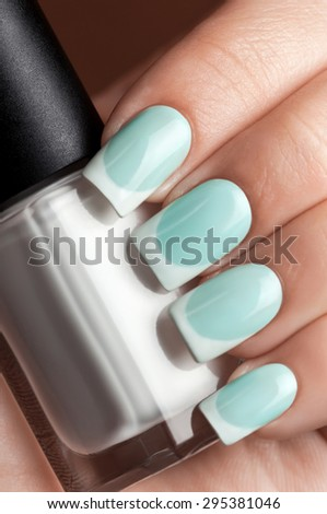 Close-up picture of beautiful nails girl. A good idea for the advertising of cosmetics for manicure. Great idea for advertising nail polish. - stock photo