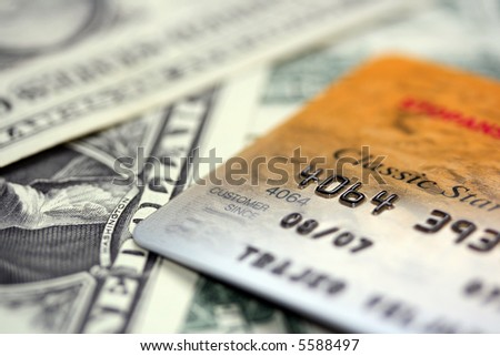 Close up picture of credit card putted on dollars - stock photo