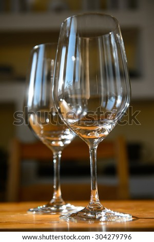 Close up picture of empty wine glasses at home - stock photo