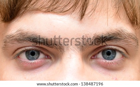 Close-up picture of eyes from a young man - stock photo