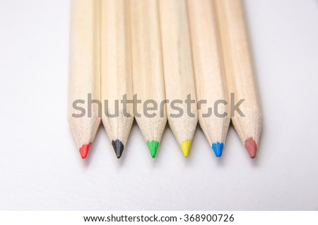close-up picture of multicolor pencils on white background - stock photo