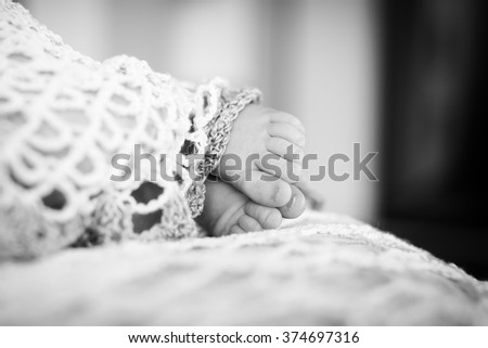 Close up picture of new born baby feet. Black-and-white photo. Baby's feet in black and white - stock photo