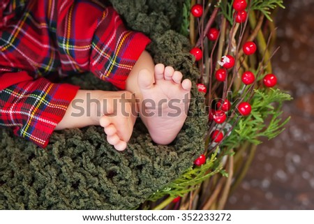 Close up picture of new born baby feet, christmas time - stock photo