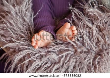Close up picture of newborn baby feet. Soft fokus - stock photo