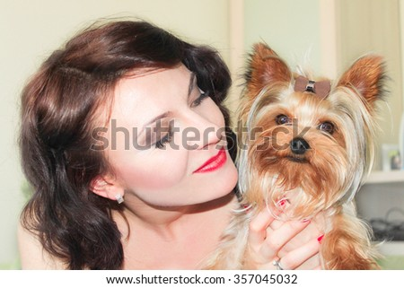 Close up picture of smiled woman and Yorkshire Terrier girl