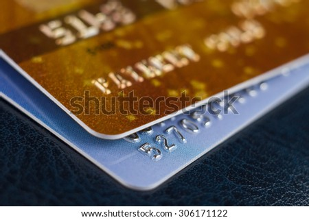 Close-up picture two credit cards with numbers. Macro. Small Depth of field - stock photo