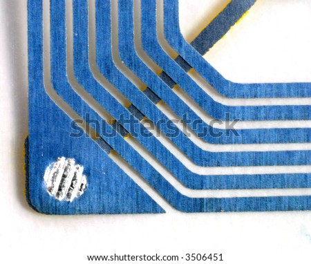 Close up pictures of a RFID tag showing the chip and antennas - stock photo