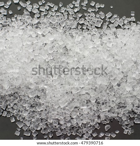 Close up pile of sugar on gray background
