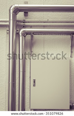 Close - up Pipeline water in industrial building - stock photo