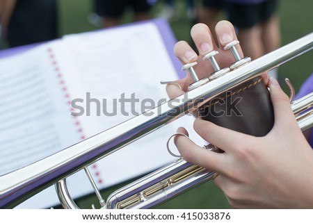 Close up Pipes in the hands of trumpet - stock photo