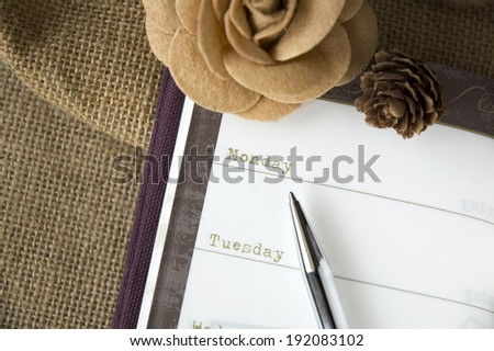 close up planner on weekly page in vintage style - stock photo