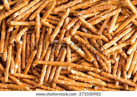 Close up Plenty Salted Baked Pretzel Sticks Wallpaper Backgrounds, Captured in High Angle View. - stock photo
