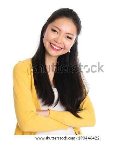 Close up portrait Asian woman isolated on white background. Casual Asian girl with long black hair smiling looking happy. - stock photo