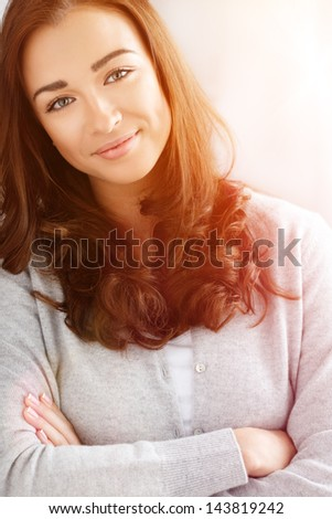 close-up portrait attractive young woman smiling - stock photo