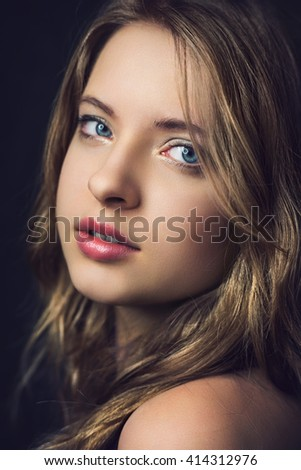 Close up portrait from a beautiful young woman - stock photo