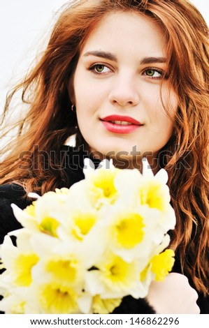 close up portrait girl with daffodils in soft selective focus - stock photo