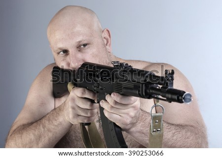 close-up Portrait man with a gun takes aim on a white background