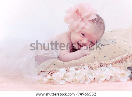 Close up portrait newborn baby lying in pillow - stock photo
