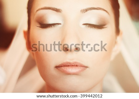 Close-up portrait of a beautiful and lovely bride with closed eyes.  - stock photo