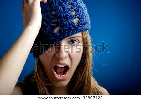 Close-up portrait of a beautiful and young woman Yelling