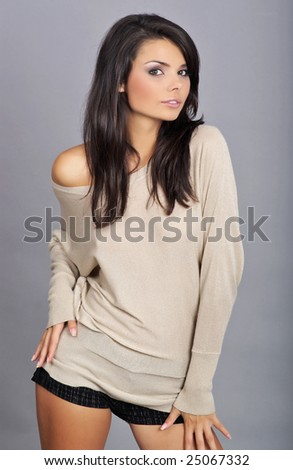 Close-up portrait of a beautiful brunette - stock photo