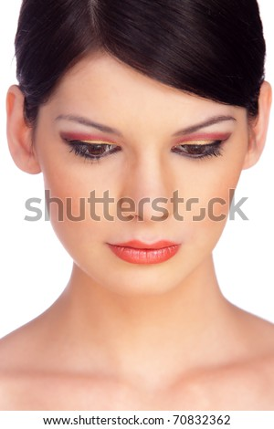 Close-up Portrait of a Beautiful Brunette Young Woman's Face. Looking down. Isolated on white - stock photo