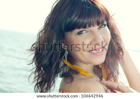 Close-up portrait of a beautiful caucasian woman with luxury hair - stock photo