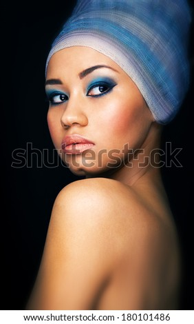 Close up portrait of a beautiful female fashion model with  turban on the head .Portrait of an African American Black Woman.Beauty.Space - stock photo