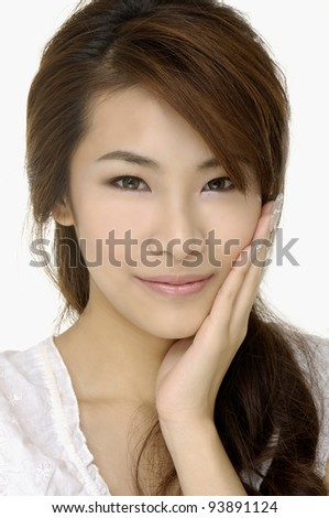 Close-up portrait of a beautiful girl smiling - stock photo