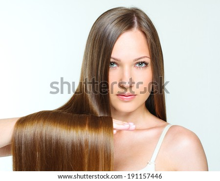 close-up portrait of a beautiful girl with brown long shiny hair. attractive girl with healthy long hair. natural hair. - stock photo