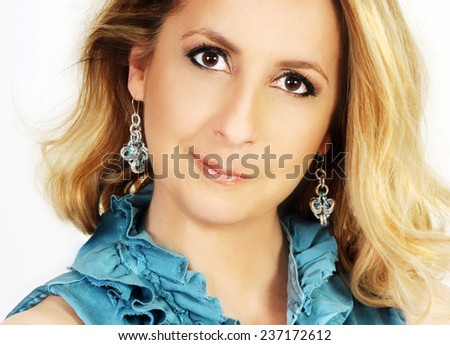 close up portrait of a beautiful middle aged blond woman with perfect make up and beautiful skin isolated on white - stock photo