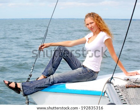 Close up portrait of a beautiful smile young woman  on the yacht - stock photo