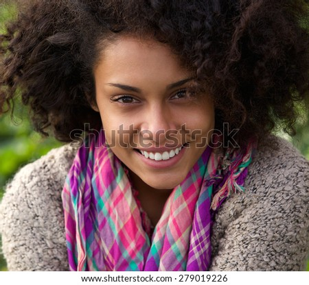 Close up portrait of a beautiful smiling african american woman - stock photo