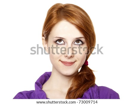 Close-up portrait of a beautiful teenager. Looking up. - stock photo