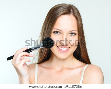 close-up portrait of a beautiful woman making makeup. perfect clean skin. fashion trendy make-up. - stock photo