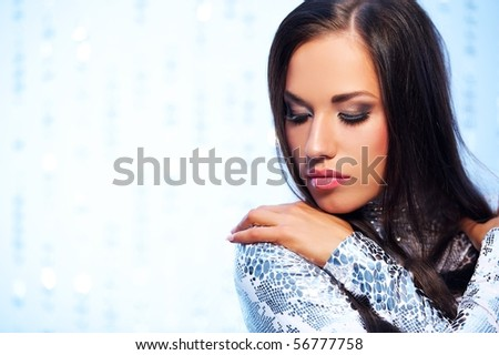 Close-up portrait of a beautiful woman over abstract background - stock photo