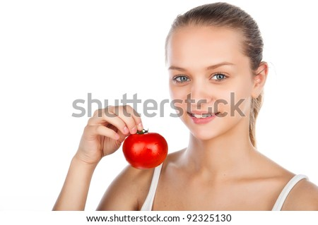 close-up portrait of a beautiful woman with a tomato, Greek salad, vegetarian food