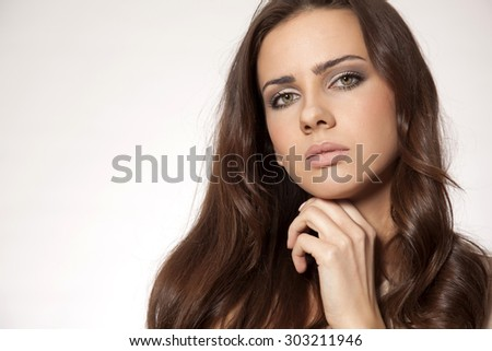 Close up portrait of a beautiful young adult attractive sexy and sensuality pretty brunette woman isolated on white background  - stock photo