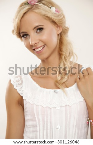 Close up portrait of a beautiful young adult sensuality attractive smiling pretty blonde woman in white elegance dress and flowers in hair isolated on white background - stock photo