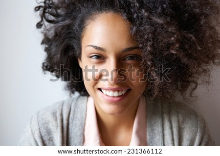 Close up portrait of a beautiful young african american woman smiling - stock photo