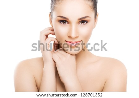 Close-up portrait of a beautiful young brunette - stock photo
