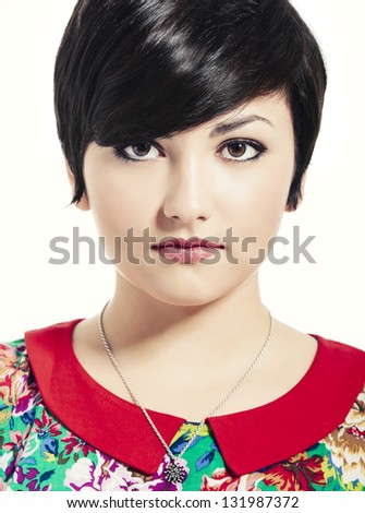 Close-up portrait of a beautiful young girl, isolated over white background - stock photo