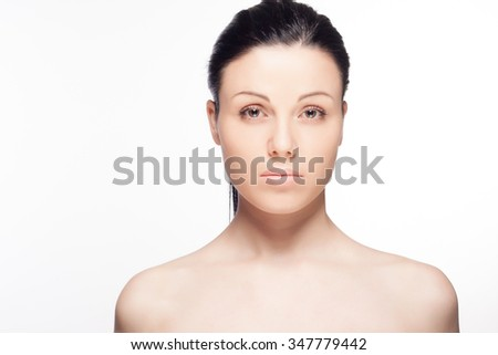 Close-up portrait of a beautiful young woman isolated on white background. Skin care concept. Natural look. Beauty portrait. Spa and health.