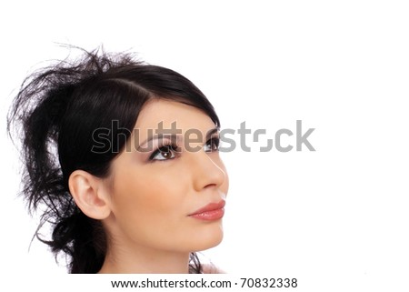 Close-up portrait of a beautiful young woman. Looking up into the corner. Copy-space and room for text on this isolate. - stock photo