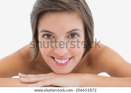 Close up portrait of a beautiful young woman over white background