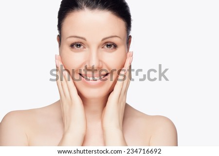 Close-up portrait of a beautiful young woman. Skin care concept. Natural look. Beauty portrait. Spa and health. - stock photo