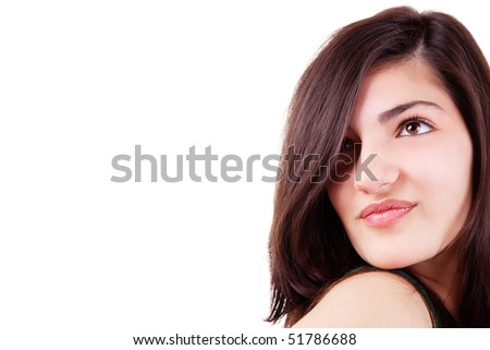 Close-up Portrait of a beautiful young woman. Studio shot.