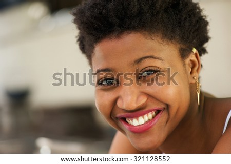 Close up portrait of a black girl laughing - stock photo
