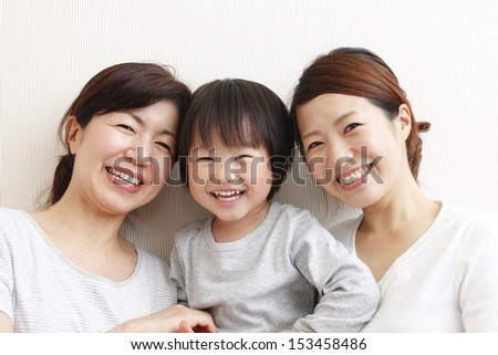 Close-up portrait of a boy laughing happily generation, grandmother, and mother.
