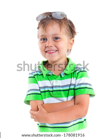 Close-up portrait of a boy with sunglasses and wearing green clothing. Isolated on white background